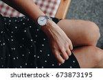 fashion details. woman wearing... | Shutterstock . vector #673873195