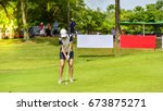 Small photo of Golfer hitting golf shot in golf course on green grass background.