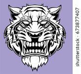 angry tiger head logo. | Shutterstock .eps vector #673877407