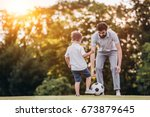 handsome dad with his little... | Shutterstock . vector #673879645