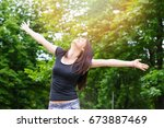 young smiling woman in sunny... | Shutterstock . vector #673887469