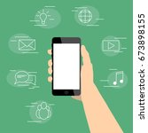 smartphone in hand surrounded... | Shutterstock .eps vector #673898155