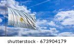 argentina flag waving on a blue ... | Shutterstock . vector #673904179