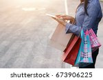 woman carrying shopping bags... | Shutterstock . vector #673906225