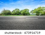 asphalt road and green tree in... | Shutterstock . vector #673916719