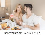 young couple travel together... | Shutterstock . vector #673947115