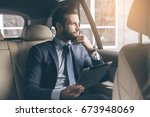 young business man test drive... | Shutterstock . vector #673948069