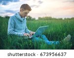 young man sitting on a green... | Shutterstock . vector #673956637