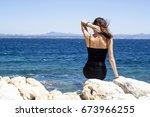 beautiful woman sitting on... | Shutterstock . vector #673966255
