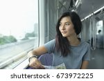 young adult girl in sky train... | Shutterstock . vector #673972225