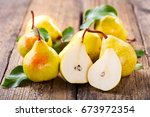 fresh pears with leaves on... | Shutterstock . vector #673972354