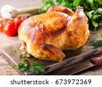 whole roasted chicken on a... | Shutterstock . vector #673972369