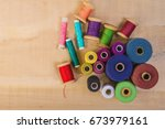 multicolored coils with threads ... | Shutterstock . vector #673979161