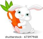 Small Lovely Rabbit Holds Gian...