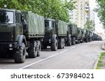 a column of military trucks.... | Shutterstock . vector #673984021
