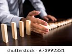 protecting assets from domino... | Shutterstock . vector #673992331