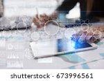 gears on virtual screen.... | Shutterstock . vector #673996561