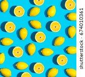 fresh lemon pattern on a vivid... | Shutterstock . vector #674010361