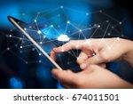 female hands touching tablet... | Shutterstock . vector #674011501