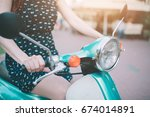 young cheerful girl driving... | Shutterstock . vector #674014891