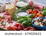set of meat antipasti served... | Shutterstock . vector #674020621