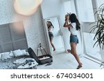 just being herself. full length ... | Shutterstock . vector #674034001