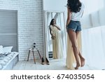 fits perfectly  rear view of... | Shutterstock . vector #674035054