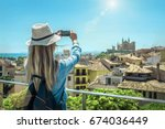 woman tourist with her phone... | Shutterstock . vector #674036449
