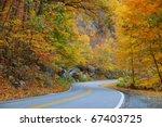 Winding Road In Autumn Woods...