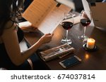 cheerful couple with menu in a... | Shutterstock . vector #674037814