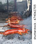pigs being cooked and roasted... | Shutterstock . vector #674062705