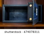 the open empty safe in a hotel... | Shutterstock . vector #674078311