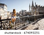 young woman tourist sitting on...   Shutterstock . vector #674093251