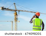Engineers And Tower Crane.