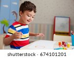 boy  drawing a picture for... | Shutterstock . vector #674101201