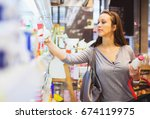 female buying dairy products. | Shutterstock . vector #674119975
