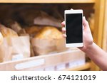 female hand holding mobile... | Shutterstock . vector #674121019