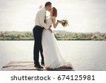 wedding couple walking on... | Shutterstock . vector #674125981