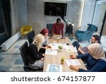 multi cultural office staff... | Shutterstock . vector #674157877