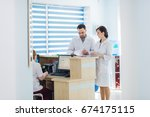 busy reception in a hospital... | Shutterstock . vector #674175115