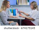 female doctor gynecologist with ... | Shutterstock . vector #674175145