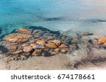 sea beach in milos island ... | Shutterstock . vector #674178661