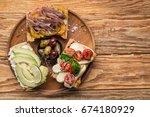 bruschetta bread with fish with ... | Shutterstock . vector #674180929