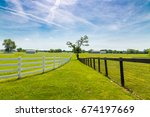 green pastures of horse farms.... | Shutterstock . vector #674197669