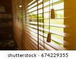 wooden blinds with sun light. | Shutterstock . vector #674229355