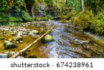 Small photo of Rocks and boulders in the Salmon habitat of the fast flowing Kanaka Creek in Kanaka Creek Regional Park near the town of Maple Ridge in British Columbia, Canada
