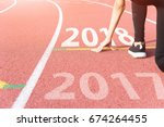 athlete on starting line... | Shutterstock . vector #674264455