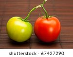 Red And Green Tomatoes On A...