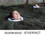 woman enjoy hot sand bath   Shutterstock . vector #674290417