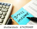 gross income written on a memo... | Shutterstock . vector #674290489